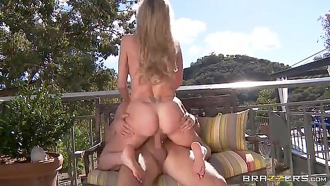 Smoking hot milf cowgirl on the terrace outdoors Brandi Love