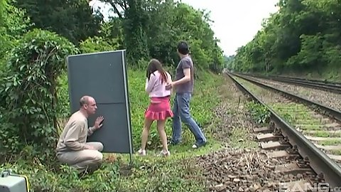 Amateur couple caught by voyeur pervert fucking by the rail road with Lucie