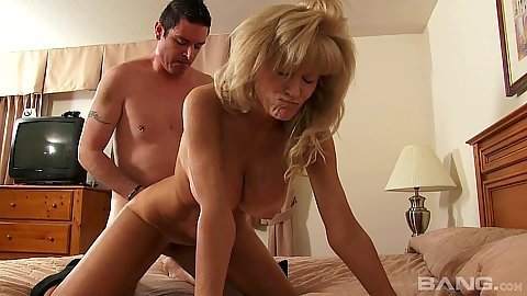 Enthusiastic wife mature doggy style sex on bed with husband