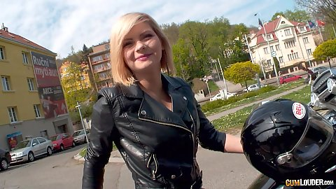Blonde fully clothed Angela driving her motorcycle in public