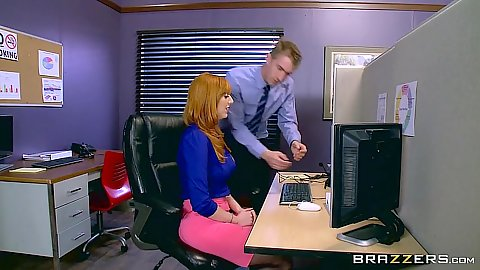 Redhead office telemarketer Lauren Phillips doing her work