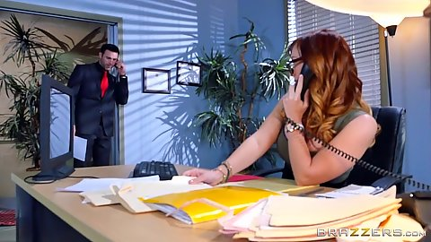 Redhead Dani Jensen working the phone at the office