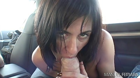 Frisky dick sucking in the back seat of a car Cecilia Vega while driving around streets