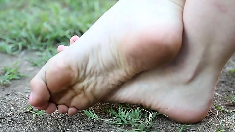 Dirty feet and smoking a cigarette barefoot outdoors Amarna Miller