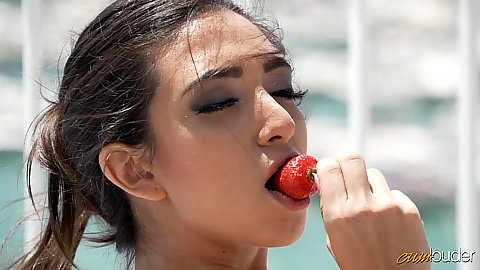 Frida Sante eating a strawberry in a very arousing way