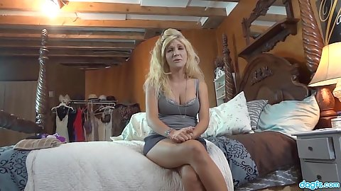 Blonde milf Emy Banx wearing her favorite tank top and hotpants shorts in bedroom filmed by husband