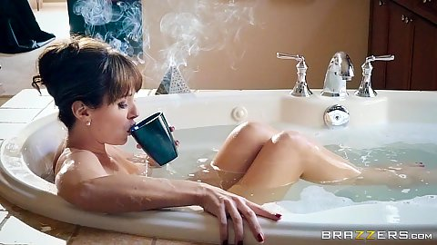 Milf Alana Cruise relaxing in bath with a cup