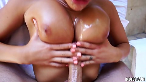 Titty fuck with oiled up boobies August Ames on massage table