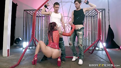 Latex girl Monique Alexander is looking attractive while squatting to suck and jerk two dicks