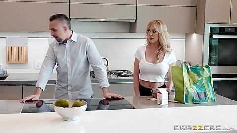 Blonde fully clothed milf Brandi Love doing something in the kitchen getting ready for party then shower
