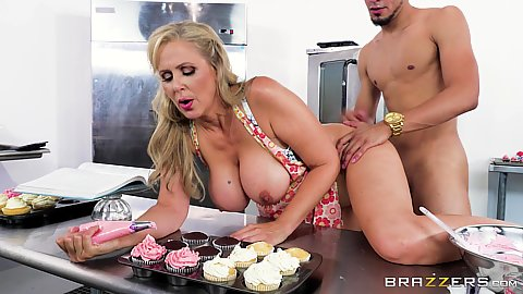 Fucking a busty milf Julia Ann as she cooks some pastries in the kitchen