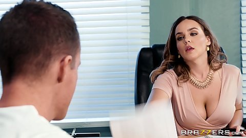 Foxy cleavage showing milf teacher Natasha Nice talking to male student