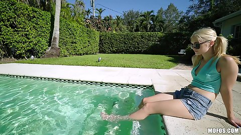Little hotpants shorts on clothed Anastasia Knight wetting her feet in the pool outdoors