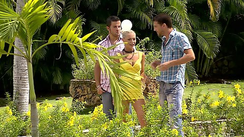 Tropical fun with Jennifer Love and two guys pulling cocks out