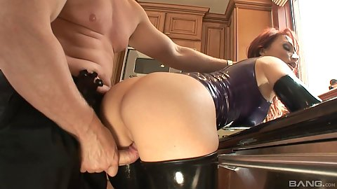 Fucked from behind bent over latex kinky milf Nikki Hunter enjoying a bit of fetish sex in the kitchen