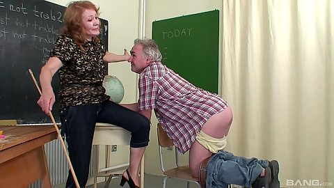 Classroom mature teacher and some guy getting spanked by ruler