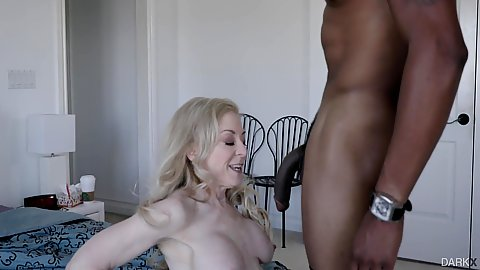 Large black cock hanging into fair skinned busty white milfs face Nina Hartley and she takes it