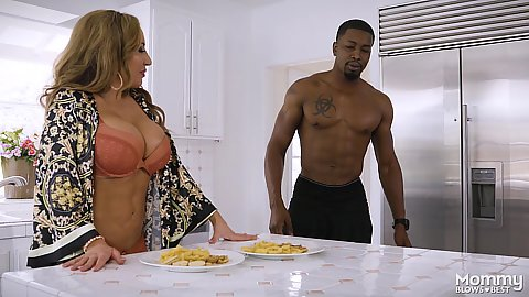 Big boobed white milf Richelle Ryan making some breakfast for daughters boyfriend and sucks his large black cock