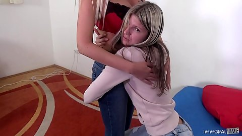 Shy teen is holding on to her milf Donna Bell and still doesnt want to strip for camera