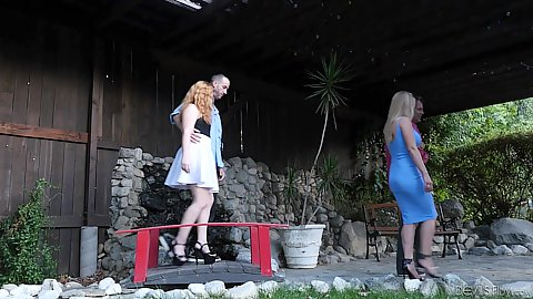 Rachel Cavalli and Lucy Foxx neighborhood swingers fucking by the front door outdoors