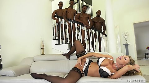 Steaming Britney Amber is teasing a group horny dudes pulling out their hard black meat for her to service