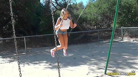 Adorable college amateur girl Blair Williams in public riding the swings on the play ground and we approach her with dirty thoughts