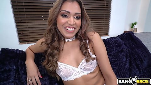 Smiling small chested latina Nicole Rey having nice large fishnet stockigns on and spreading her pussy lips