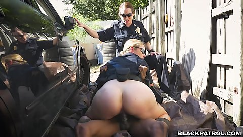 Outdoors big ass police offcer fucks black shaft behind cop car right in public Joslyn and Maggie Green