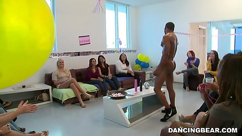 Room full of very horny girls enjoy watching male stripper dance around naked