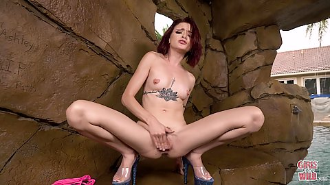 Lola Fae found a quiet place at a pool party an squats to play with her trimmed vagina opening solo