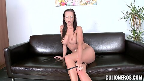 Casting scene with a busty leggy brunette Cindy Dollar getting a dildo to show us her pussy is wet