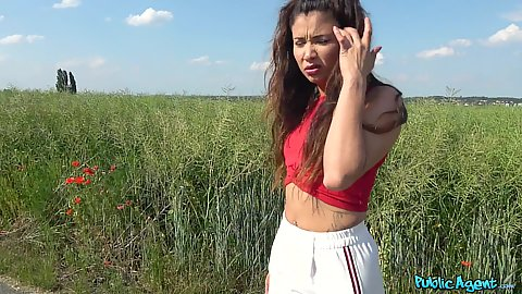 Outdoors by the field euro girl in white pants Jade Presley gets some cash to show us her little boobies