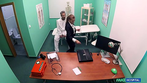 Medical doctors exam room with clothed real estate agent Silvia Dellai entering to get a check up