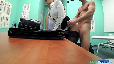 Fully clothed business woman realtor Silvia Dellai getting her pussy verified by the best doctor in town from behind