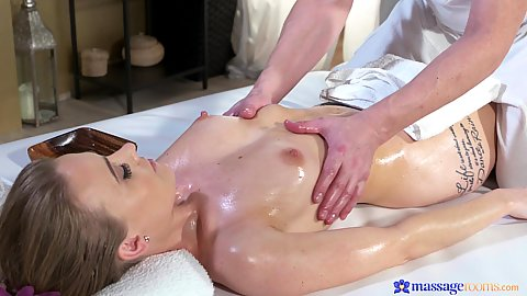 Carmel Anderson getting an oil massage and those hands are about to reach her good set of boobs