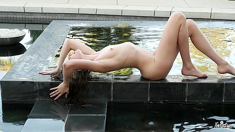 Sexy little petite college babe glamcore playing with her naked body splashing around in water