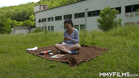 Solo Stefanie looking to have a pleasant day naked tanning on a public secluded place behind the factory on the grass when a peeping pervert interrupts her time and pulls his dick out shocking her