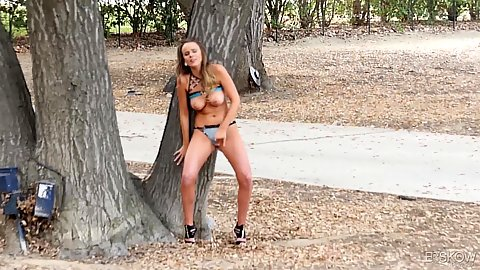 Natural girl masturbates by a tree in the public park Alexis Adams showing her boobs hiding behind a tree