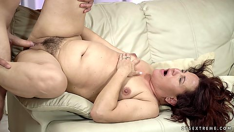 Hairy raunchy mature Red Mary likes to get the feeling of a young mans throbbing sausage in her old coochie from time to time