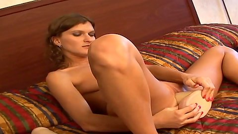 Vintage clip of insane girl using incredibly huge toys in her twat make it stretch in bed solo