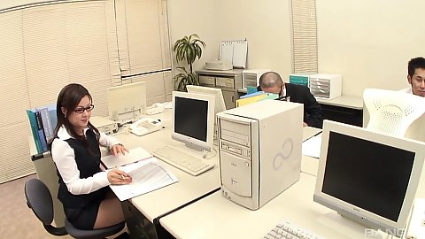 New office girl asian hottie in glasses is working behind her computer and men want to touch her all over in a group