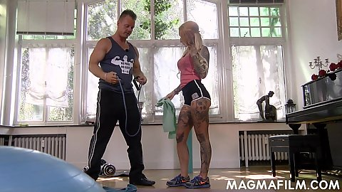 Athletic blonde workout milf in shorts Lucia De Luxe following instructions to do her exercise with private trainer