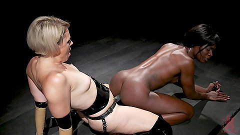 Strap on rear fucking black submissive girl with small chest size keeping her on the floor and on the edge of climax Ana Foxxx and Helena Locke