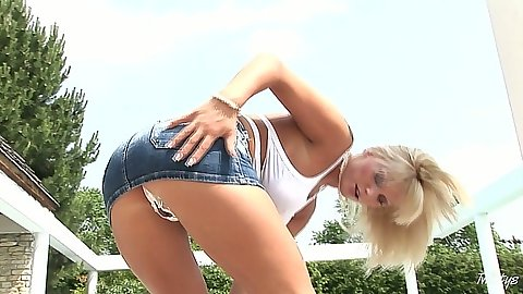 Outdoor upskirt from Sheila Grant wearing a short miniskirt