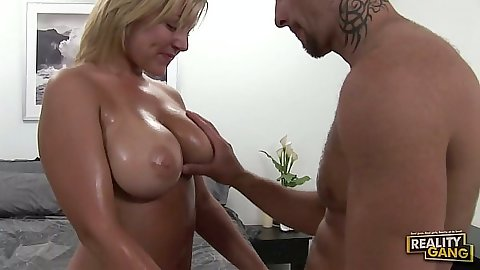 Big tits oiled up Velicity Von titty fucks and sucks dick