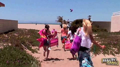 Lesbians Lynn Love and JC Simpson and Kandi Milan go to the beach