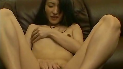 Hairy pussy solo asian masturbation on the couch