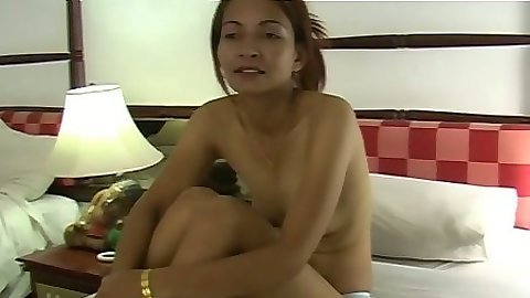 Asian solo posing half naked and revealing hairy pussy