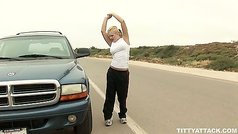 Blonde Andi Anderson is having car trouble outdoors
