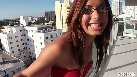 Abbi Roads latina posing on the balcony solo
